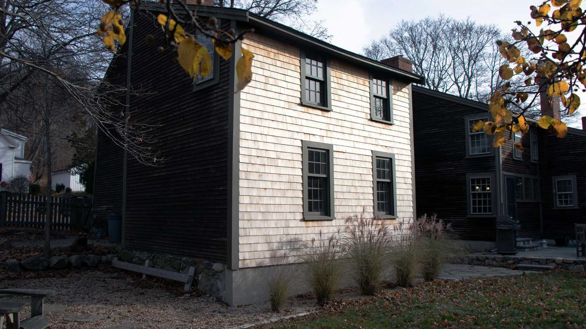 An exterior view - Joset shored up an existing antique addition on this Ipswich property, requiring a hand-dug foundation and hidden steel reinforcement.